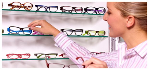 woman picking out glasses